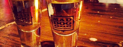 Mad Dog & Beans Mexican Cantina is one of the man's hat is tan.