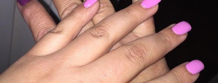 Elite Nails & Tan is one of Locais curtidos por Alejandra.