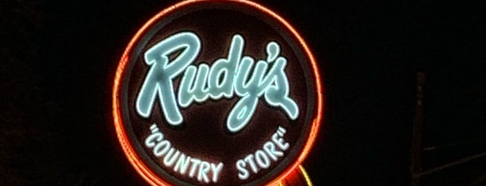 Rudy's Country Store & Bar-B-Q is one of Lieux qui ont plu à Den.
