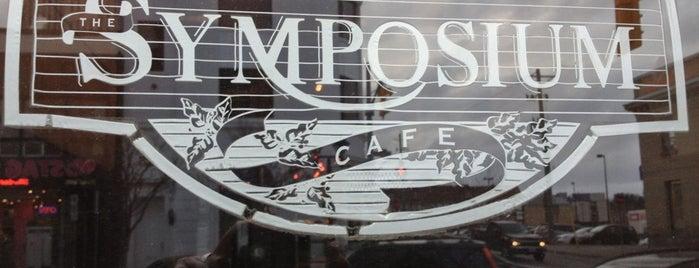Symposium Café Restaurant & Lounge is one of Tempat yang Disukai Shauna.