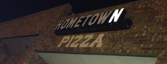 Hometown Pizza is one of Tempat yang Disukai KATIE.
