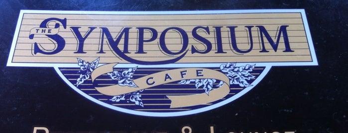 Symposium Cafe Restaurant & Lounge is one of Orte, die Janet gefallen.