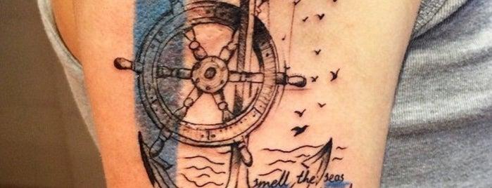 lady needle tattoo is one of Tempat yang Disukai Seda.