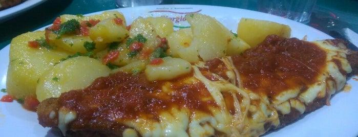 Pizzeria y Restaurante Giorgio's is one of Pizzerias Italiana comida.