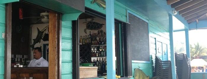 Rainbow Grill is one of Belize🌊🍹.
