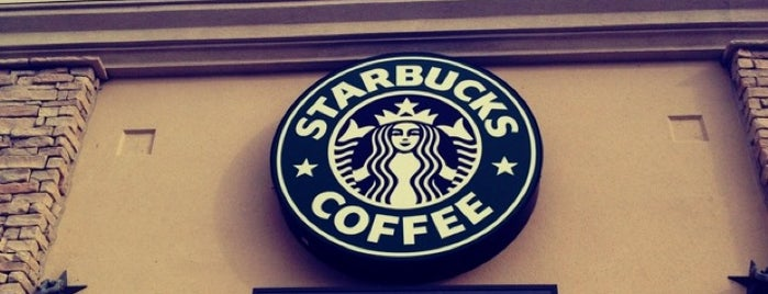 Starbucks is one of สถานที่ที่ Damien ถูกใจ.