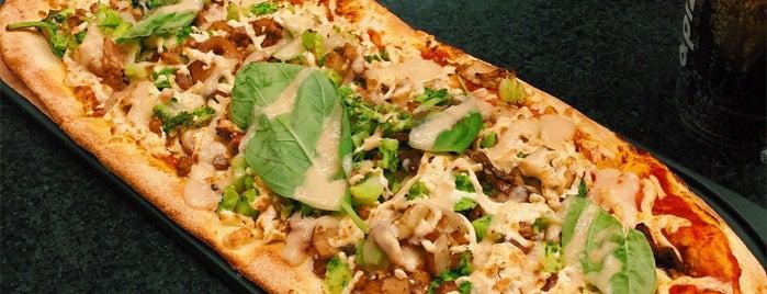 &pizza is one of Lugares favoritos de Julia.
