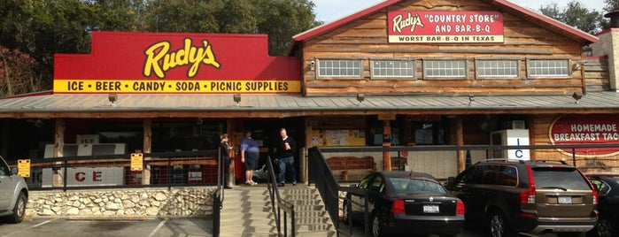 Rudy's Country Store & Bar-B-Q is one of Tempat yang Disukai Dustin.
