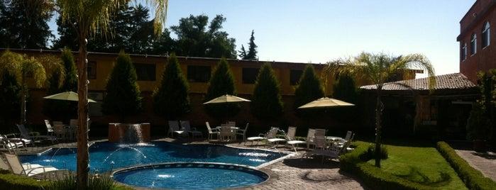 Hotel Quinto Sol is one of Lieux qui ont plu à Luis Felipe.