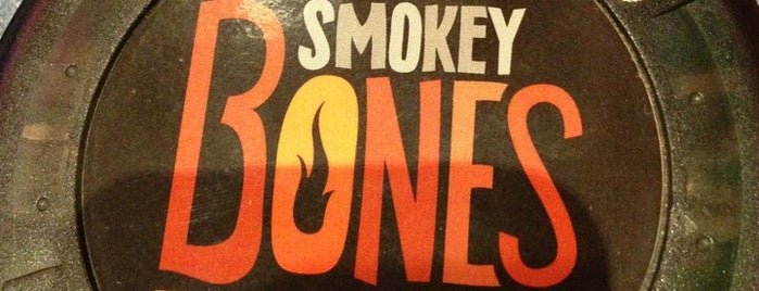 Smokey Bones Bar & Fire Grill is one of DRINKING out of town.