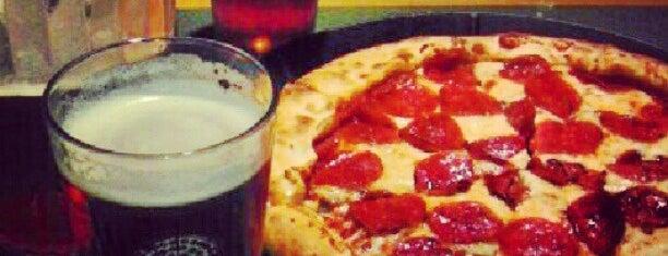 Woodstock's Pizza is one of Locais curtidos por Fabio.