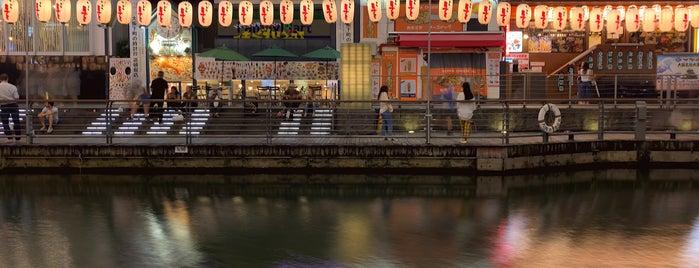 Tombori Riverwalk is one of Osaka.