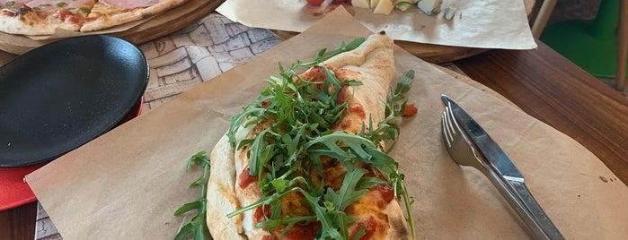 La Prima Pizza is one of Vladimir 님이 저장한 장소.