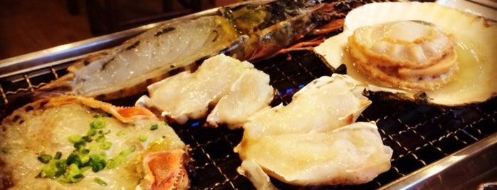 磯丸水産 西新宿1丁目2号店 is one of Lieux sauvegardés par Brian.
