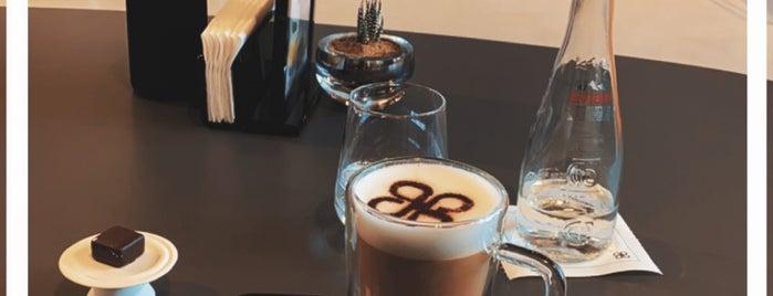 Patchi Café is one of Queen'in Kaydettiği Mekanlar.