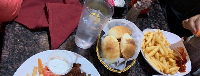 Mezza Mediterranean Grille is one of Posti che sono piaciuti a Kayla.