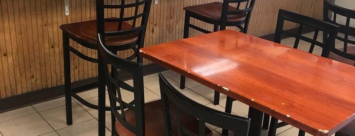 Golden Krust Caribbean Restaurant is one of Tempat yang Disukai Brittany.