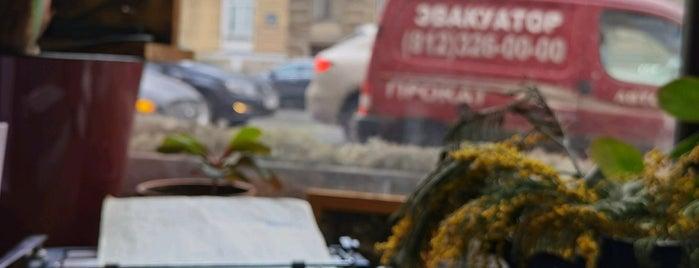 Le Moniteur Café is one of места.
