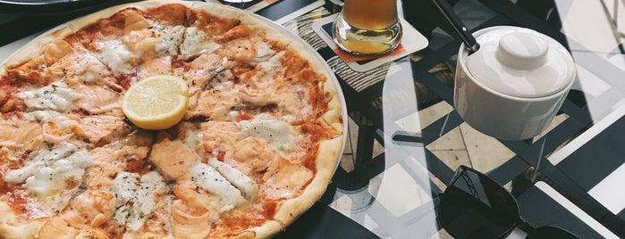 Mk Pizza is one of Tempat yang Disukai Max.
