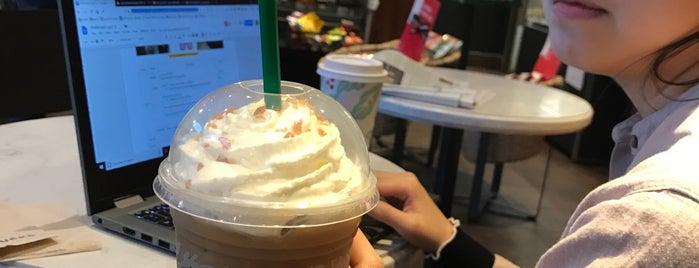 Starbucks is one of Orte, die Jim gefallen.