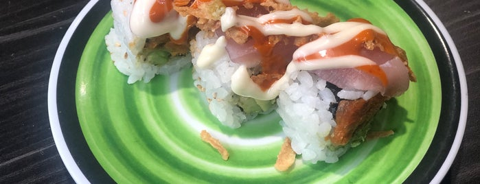 Kura Revolving Sushi Bar is one of Tempat yang Disukai Ms. Damaris.