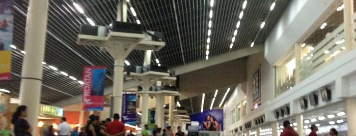 Aeropuerto Internacional Ramon Villeda Morales is one of Tempat yang Disukai Andrew.