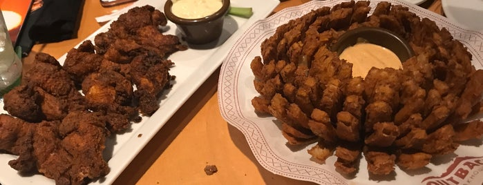 Outback Steakhouse is one of Lieux qui ont plu à Adriane.