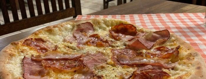 Pizzeria Capretto is one of Lugares favoritos de Anastasia.