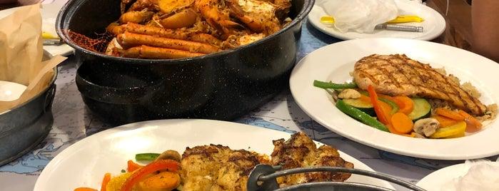 Joe's Crab Shack is one of Tempat yang Disukai Hessa Al Khalifa.