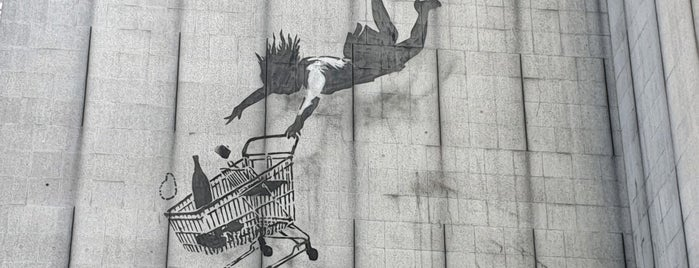 Banksy - Falling Shopper is one of My Saved Venues Abroad.