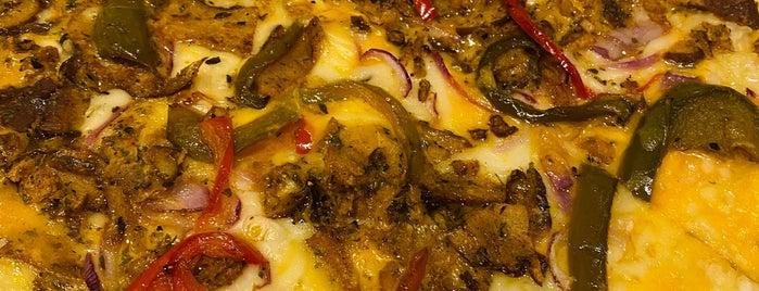 Screamer's Pizzeria is one of NYC Vegan.