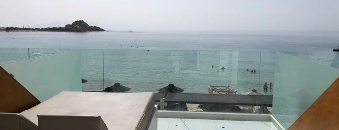 Mykonos Kosmoplaz Beach Resort Hotel is one of Tempat yang Disimpan Alper.