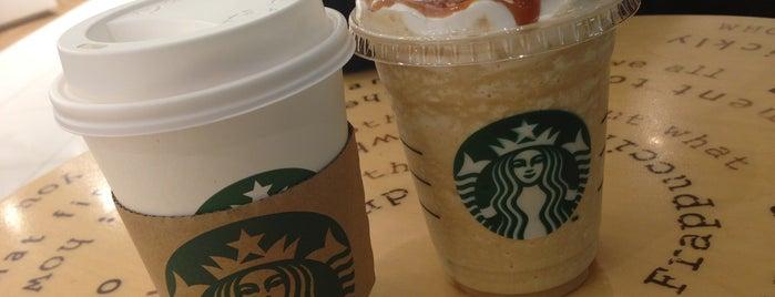 Starbucks is one of Lieux qui ont plu à LuLu.