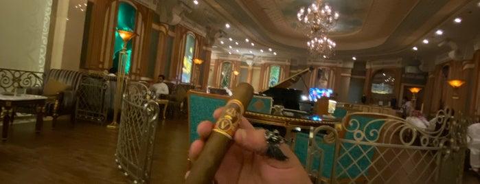Turquoise Cigar Lounge - Ritz Carlton is one of สถานที่ที่ Waleed ถูกใจ.