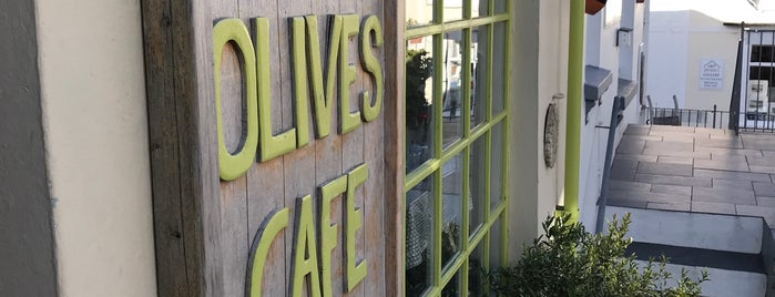Olive's Cafe is one of Lugares favoritos de gcyc.