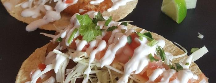Kim's Taco is one of สถานที่ที่ Thomas ถูกใจ.