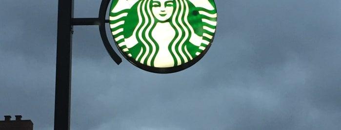 Starbucks is one of Tempat yang Disukai Neil.