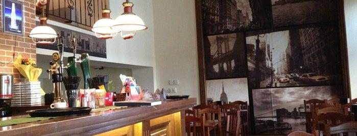 Manhattan Pub & Pizza is one of Posti che sono piaciuti a Irina.