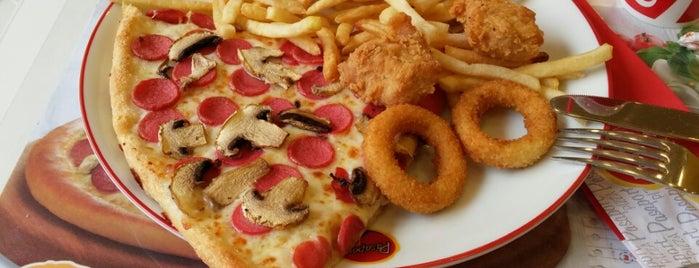 Pasaport Pizza is one of สถานที่ที่บันทึกไว้ของ Emre.