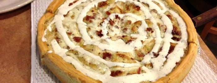 Delfino's Pizza is one of สถานที่ที่ Seth ถูกใจ.