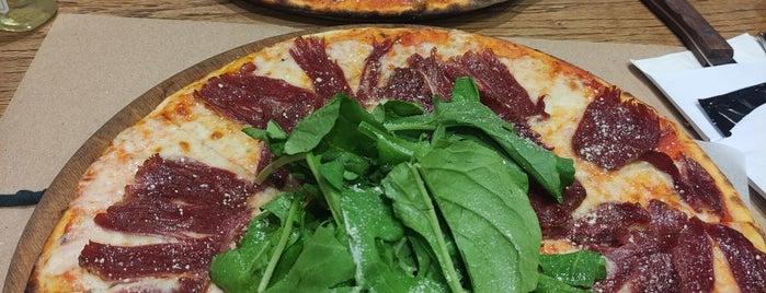 Pizza Locale is one of สถานที่ที่บันทึกไว้ของ Emre.