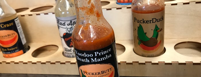 PuckerButt Pepper Company is one of Lugares favoritos de Greg.