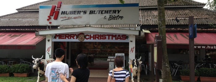 Huber's Butchery & Bistro is one of Orte, die Dennis gefallen.