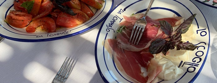 Ristorante Lo Scoglio is one of T+L's Guide to Eating Like a Local.