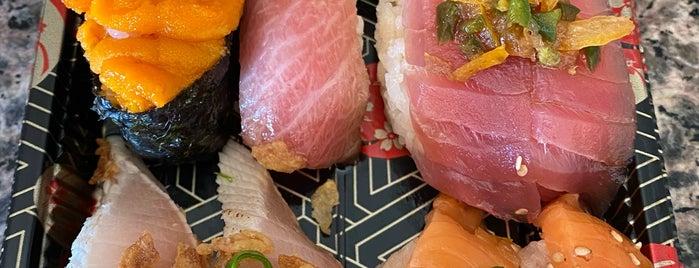 Kura Revolving Sushi Bar is one of สถานที่ที่บันทึกไว้ของ Butch.