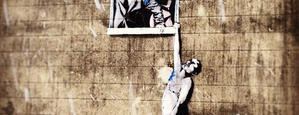 """Banksy's """"Well-Hung Lover"""" is one of Before I Die."""