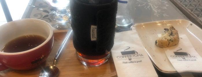 Coffeetopia is one of Locais curtidos por Ercan.