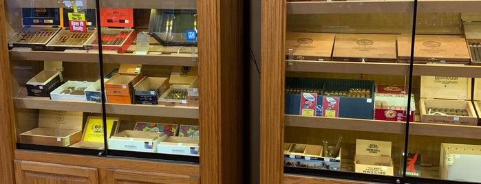 Cigar Cigars is one of สถานที่ที่ John ถูกใจ.