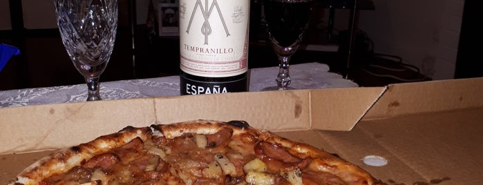 Pizza E Vino is one of สถานที่ที่ Mike ถูกใจ.