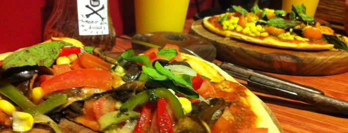 Romanos Pizza is one of Ruta Vegetariana.